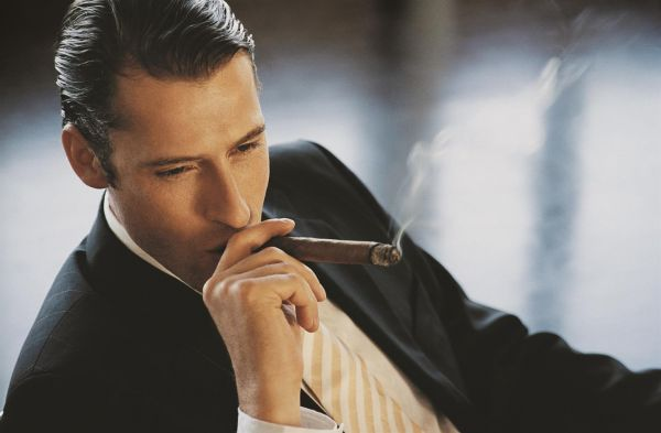 Rich-Man-Smoking-Cigar